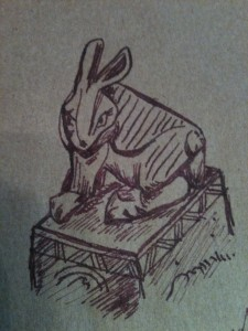 A sketch of a rabbit in reddish purple ink on brown paper