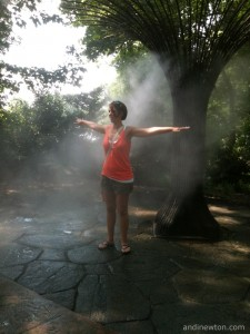 Heather stands in the mist from a misting station