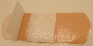 A self-adhesive bandage partially opened