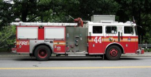 A red firetruck parked on the street