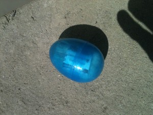 A blue plastic Easter egg